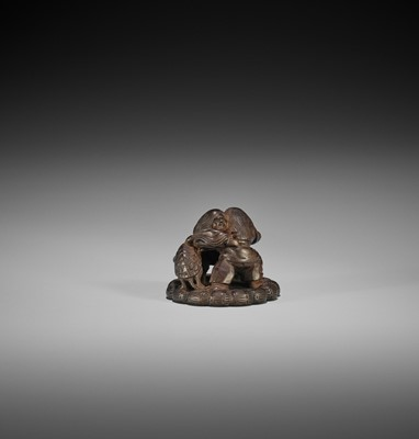 Lot 157 - HEIZO: A DARK WOOD NETSUKE OF TWO SHOJO WRESTLING AND TORTOISE REFEREE