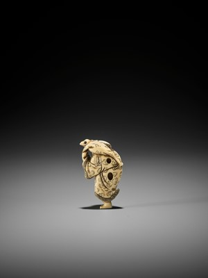 YOSHINAGA: AN IVORY NETSUKE OF GAMA SENNIN WITH A PEACH AND HIS THREE-LEGGED TOAD