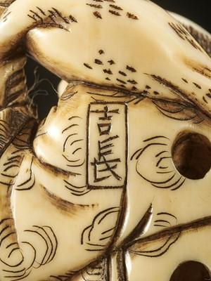 Lot 37 - YOSHINAGA: AN IVORY NETSUKE OF GAMA SENNIN WITH A PEACH AND HIS THREE-LEGGED TOAD