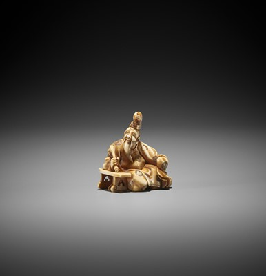 Lot 247 - SARUKO: A STAINED IVORY NETSUKE OF A CALLIGRAPHER