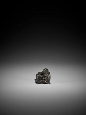 Lot 43 - OKATOMO: A RARE SHITAN WOOD NETSUKE OF A MONKEY