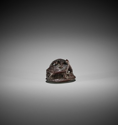 Lot 156 - TOMOKAZU: A WOOD NETSUKE OF THREE TURTLES IN A PYRAMID