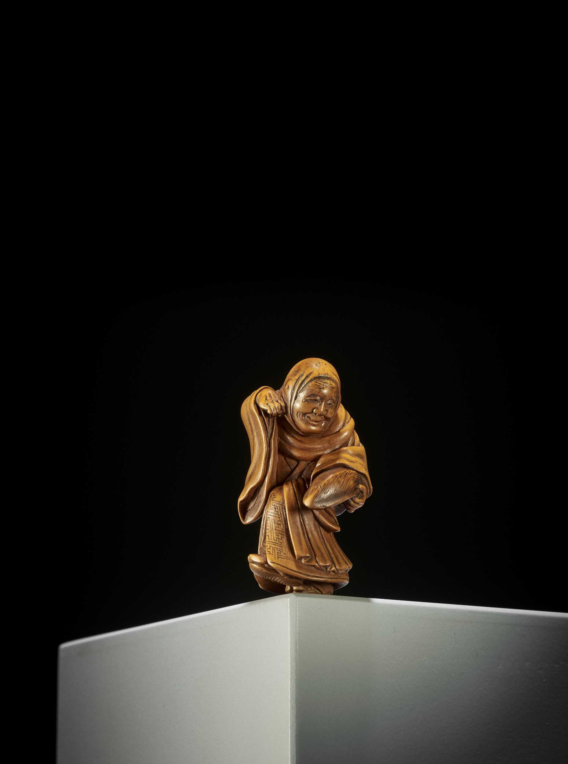 Lot 152 - MATSUDA SUKENAGA: A SUPERB WOOD NETSUKE OF A FOX PRIEST IN MID-TRANSFORMATION