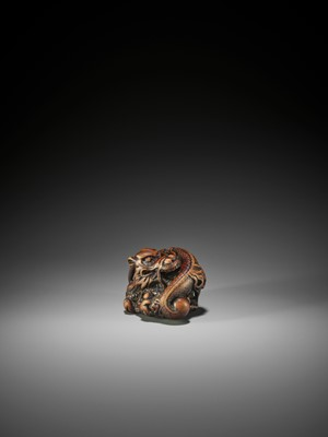 Lot 57 - A POWERFUL AND RARE WOOD NETSUKE OF A COILED DRAGON, ATTRIBUTED TO MITSUHARU