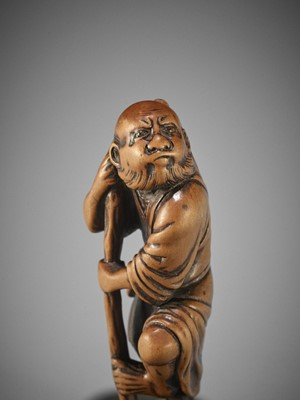 Lot 182 - MINKOKU I: A WOOD NETSUKE OF TEKKAI SENNIN