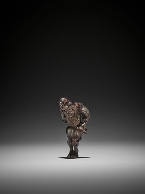 Lot 31 - A RARE DARK WOOD NETSUKE OF A RONIN DRAWING HIS SWORD