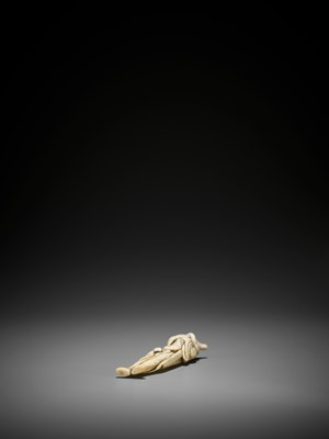 Lot 24 - A RARE AND TALL IVORY NETSUKE OF A FOREIGNER