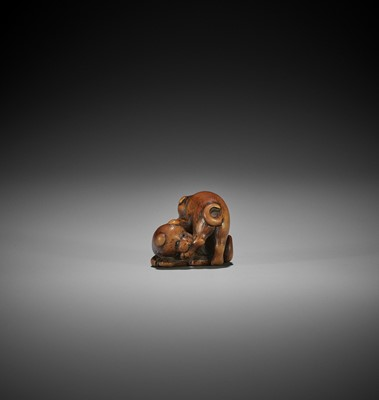 Lot 158 - A WOOD NETSUKE OF TWO PUPPIES