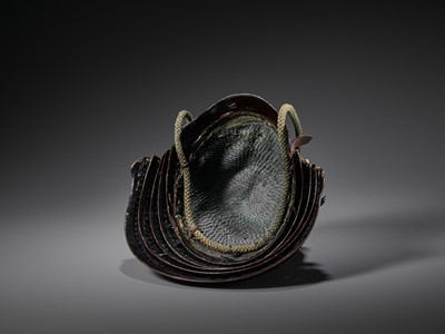 Lot 52 - AN IMPORTANT KO-BOSHI KABUTO (HELMET WITH STANDING RIVETS) WITH IMPRESSIVE KEN MAEDATE (FRONT CREST)