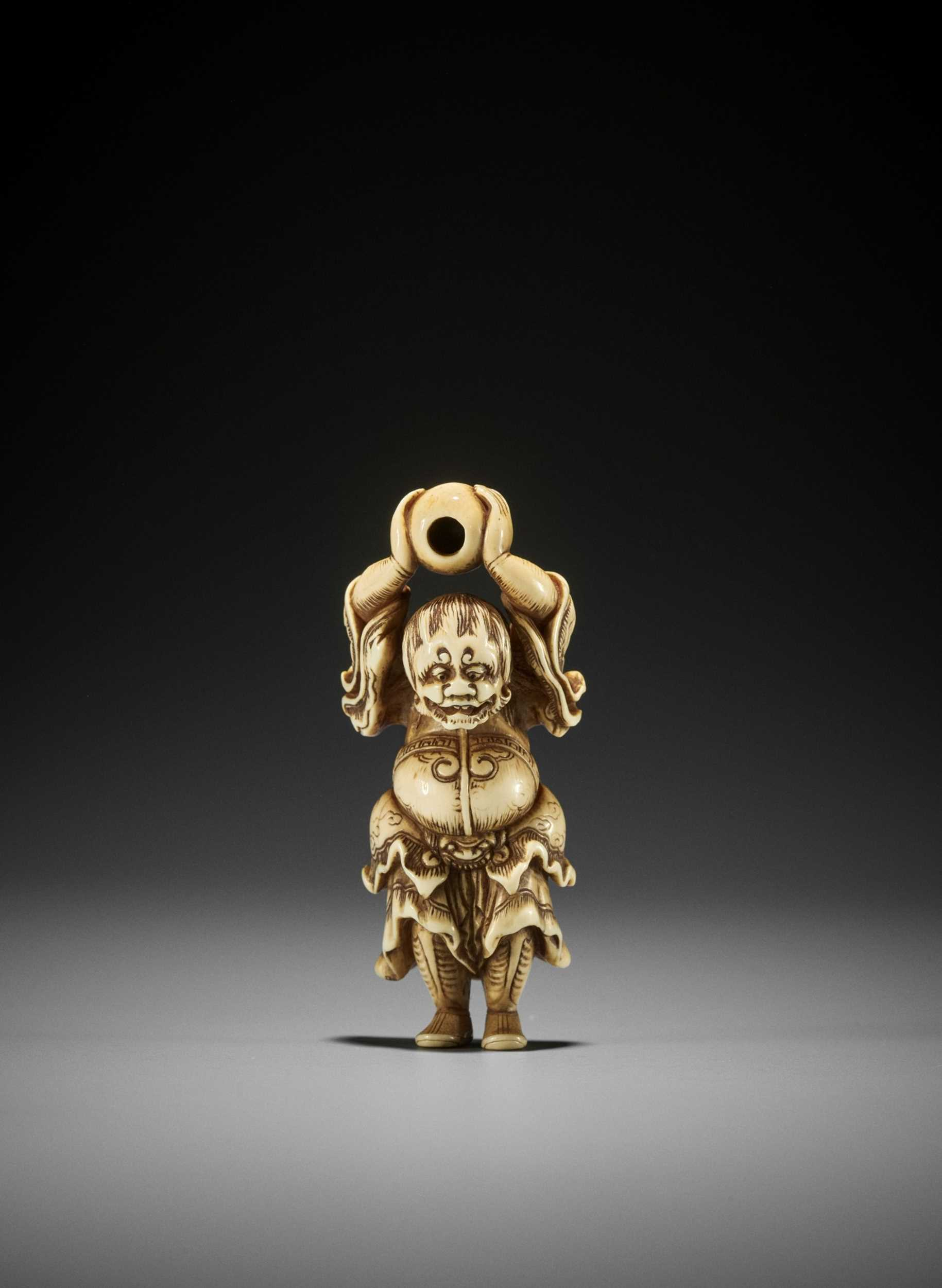 Lot 65 - A RARE AND SUPERB IVORY NETSUKE OF RYUJIN WITH TAMA, ATTRIBUTED TO SANKO