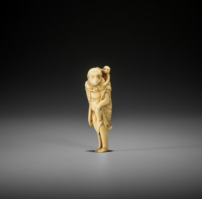 AN UNUSUAL AND EARLY IVORY NETSUKE OF A MONKEY AS A SARUMAWASHI