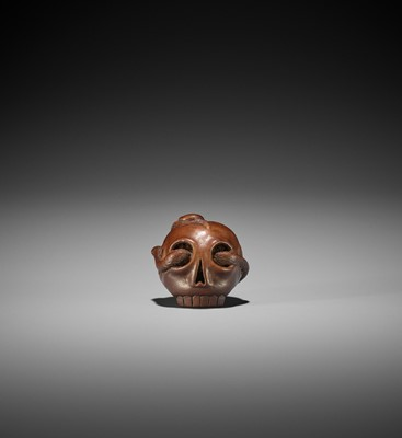 Lot 104 - TOMIN: A RARE WOOD NETSUKE OF THE SANSUKUMI ON SKULL