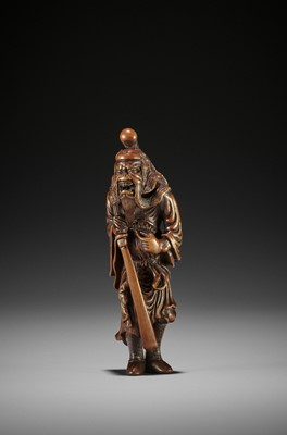 A SUPERB AND TALL WOOD NETSUKE OF SHOKI