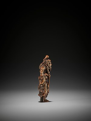 Lot 22 - A SUPERB AND TALL WOOD NETSUKE OF SHOKI