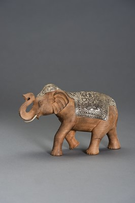 Lot 540 - A WOOD AND SILVERED METAL CAPARISONED ELEPHANT