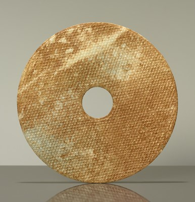 A PALE GREEN JADE BI DISC SYMBOLIZING THE UNIVERSE, COUNTERPART TO THE BI DISCS OF THE ROYAL TOMB OF NANYUE