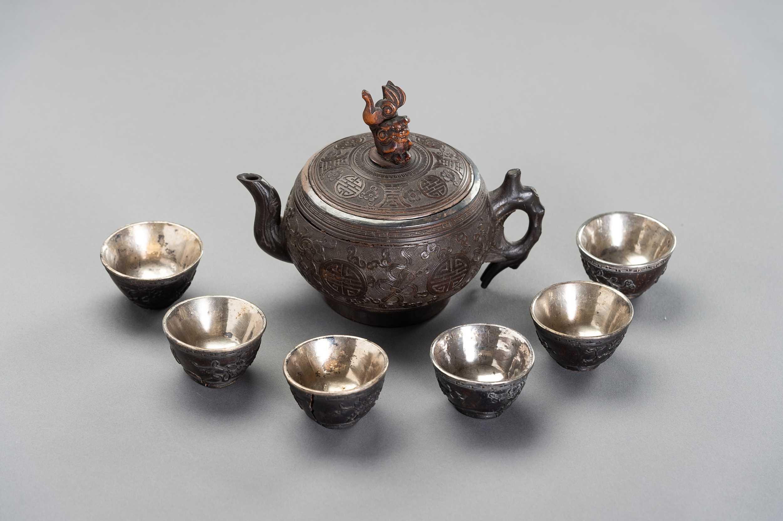 Lot 93 - A CONONUT AND SILVER TEA SET