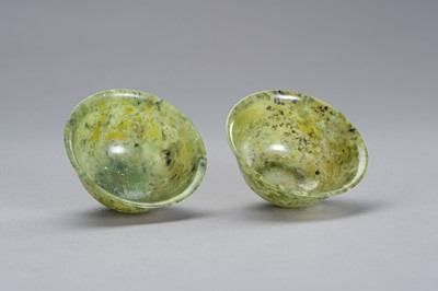 Lot 165 - A MOTTLED PAIR OF SPINACH GREEN JADE BOWLS