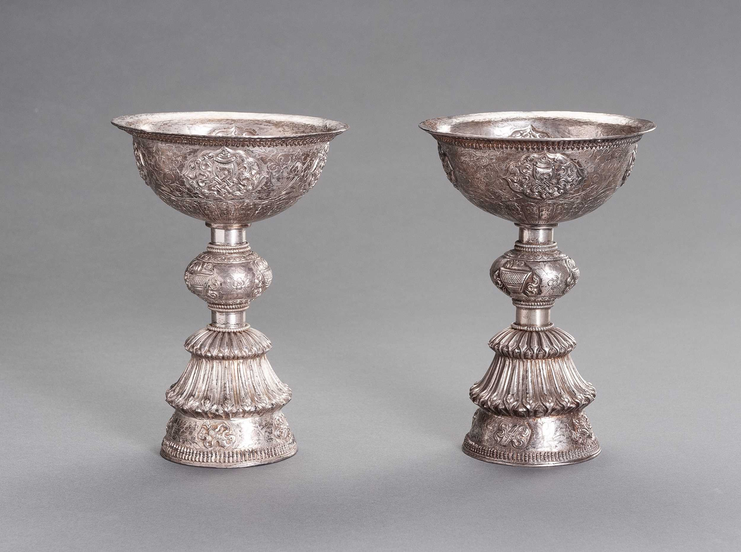Lot 106 - A LARGE PAIR OF SILVER BUTTER LAMPS