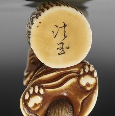 HOGYOKU: A FINE IVORY NETSUKE OF A TANUKI PRIEST