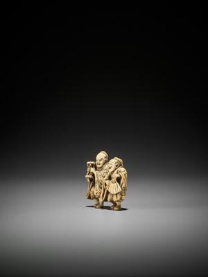 A SPIRITED IVORY NETSUKE OF TWO MANZAI DANCERS