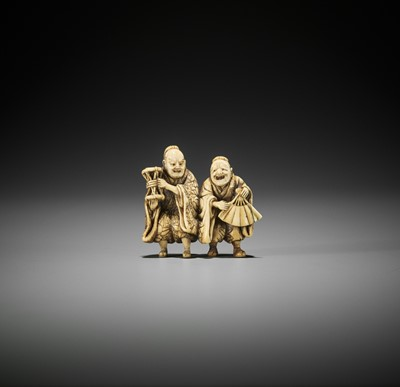 Lot 181 - A SPIRITED IVORY NETSUKE OF TWO MANZAI DANCERS