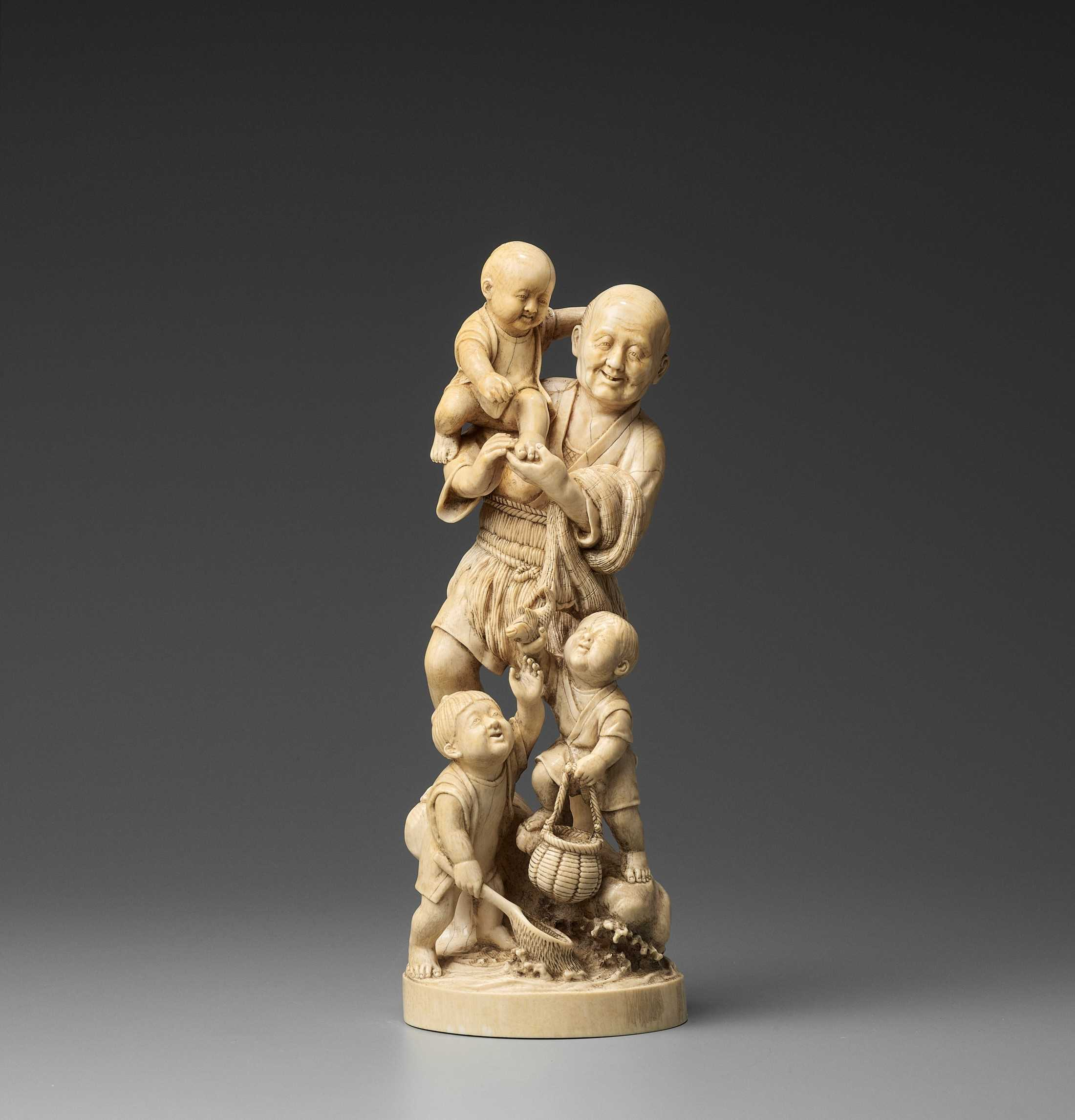 Lot 154 - TOGA: A LARGE TOKYO SCHOOL IVORY OKIMONO OF A FISHERMAN AND THREE BOYS