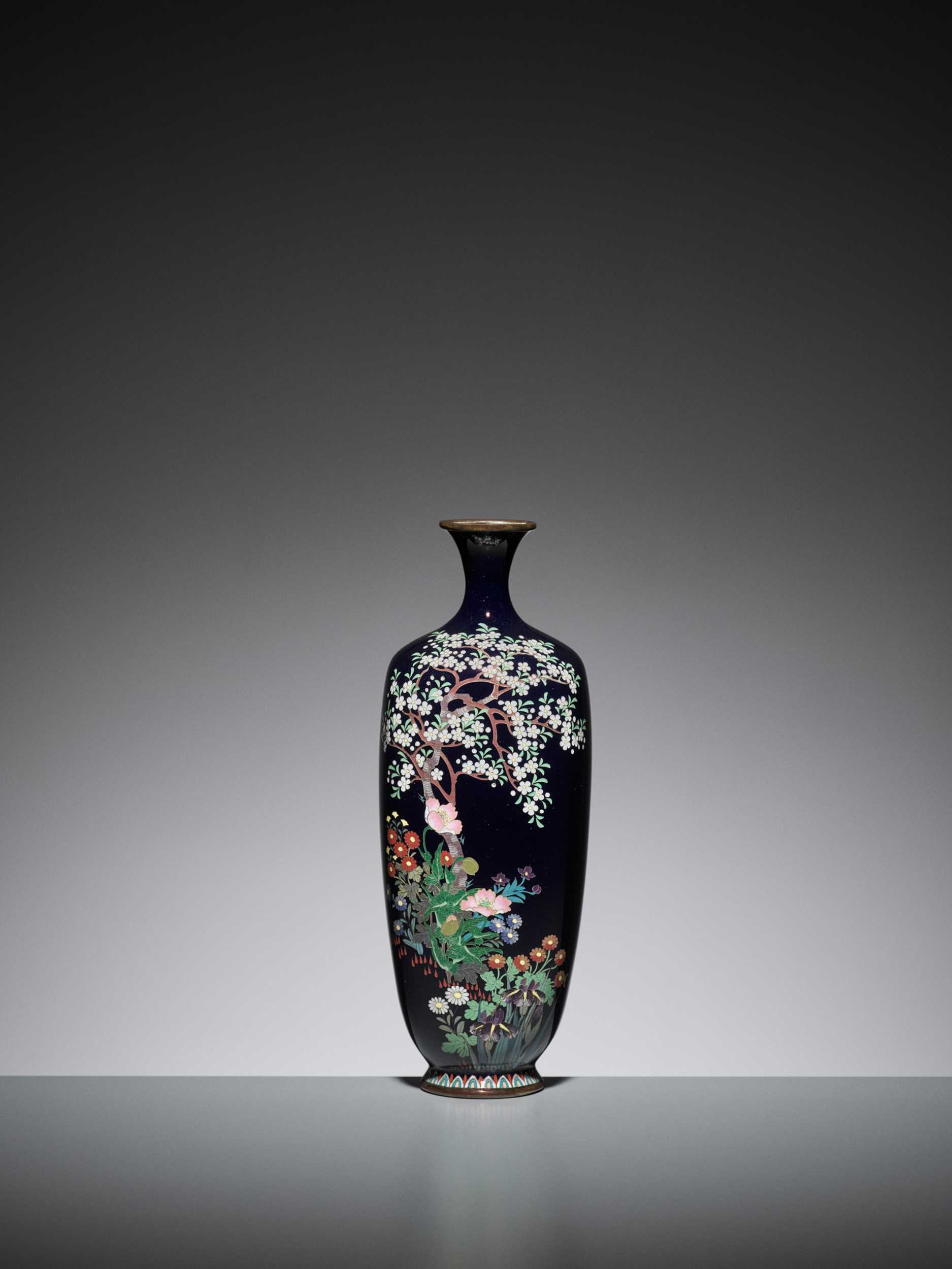Lot 66 - A MIDNIGHT BLUE CLOISONNÉ ENAMEL VASE WITH CHERRY TREE AND FLOWERS