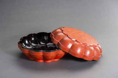 Lot 142 - A LARGE LOBED LACQUER BOX