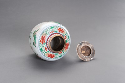 Lot 301 - A WUCAI ENAMELED PORCELAIN JAR AND COVER, MING DYNASTY