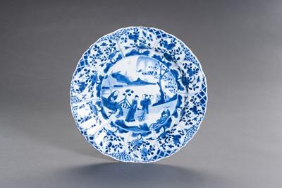 Lot 326 - A BLUE AND WHITE PORCELAIN 'FIGURAL SCENE' LOBED DISH, KANGXI