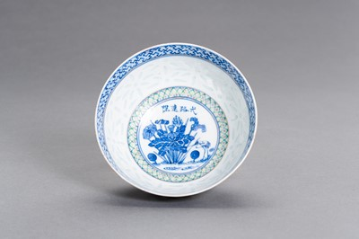 Lot 372 - A BLUE AND WHITE AND ENAMELED PORCELAIN 'RICE GRAIN' BOWL, GUANGXU MARK AND PERIOD