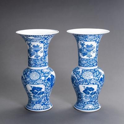 Lot 354 - A PAIR OF BLUE AND WHITE PORCELAIN 'KANGXI REVIVAL' YEN YEN VASES, QING DYNASTY