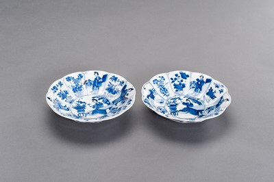 Lot 325 - A PAIR OF BLUE AND WHITE 'LADY IN GARDEN' LOBED DISHES, KANGXI