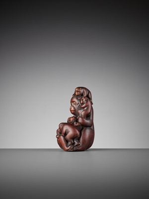 A WOOD OKIMONO OF A MONKEY WITH FOUR YOUNG