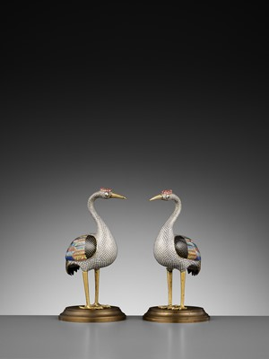 Lot 12 - A PAIR OF GILT BRONZE AND CLOISONNÉ ENAMEL FIGURES OF CRANES, QING DYNASTY