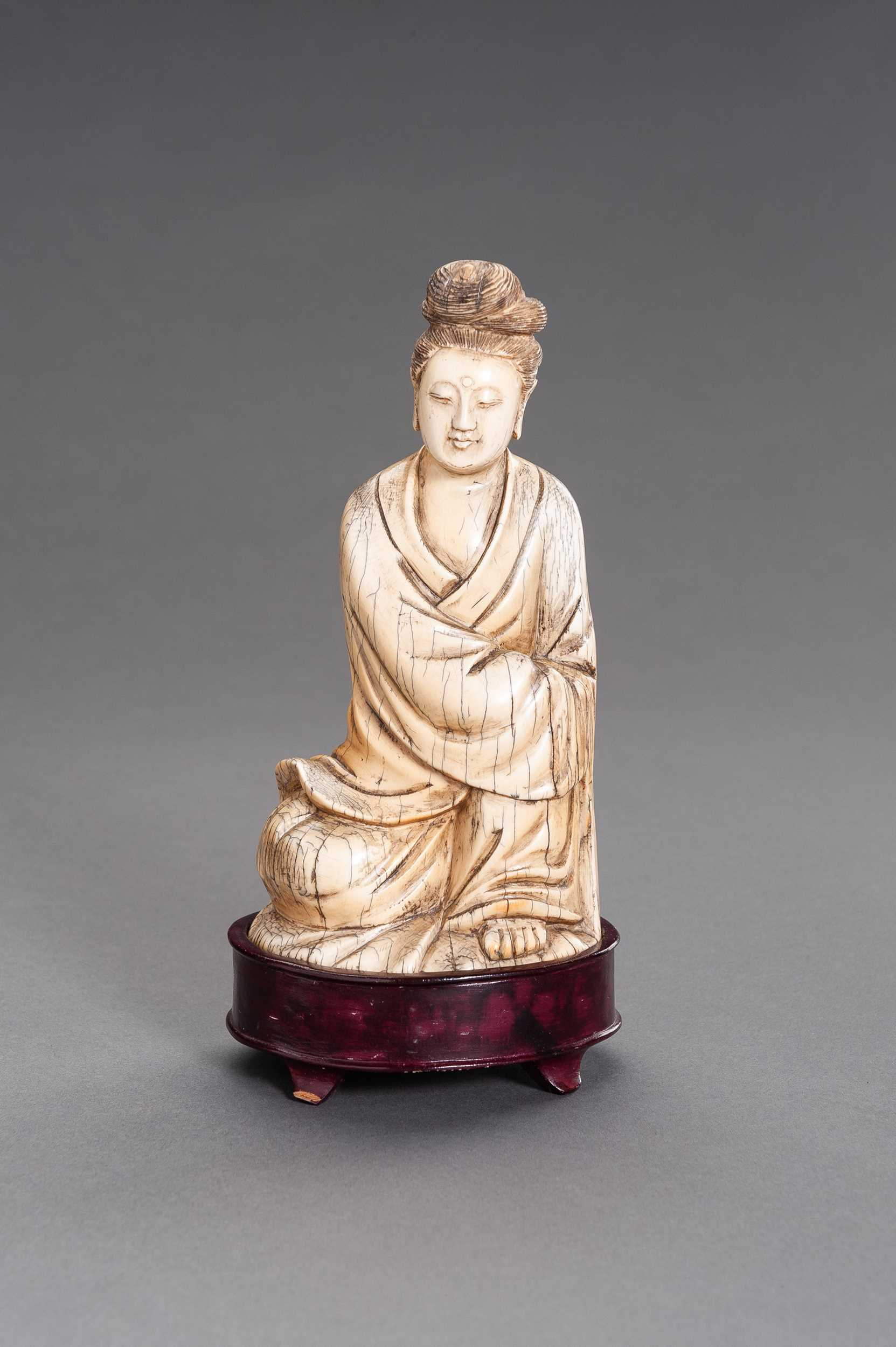 Lot 53 - A MING-STYLE IVORY FIGURE OF GUANYIN, QING DYNASTY
