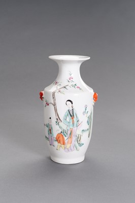 Lot 423 - A MOLDED AND ENAMELED PORCELAIN 'COURT LADY AND CHILDREN' VASE, REPUBLIC