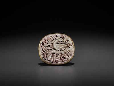 Lot 92 - A RETICULATED CELADON JADE 'PHEASANT' PLAQUE, MING DYNASTY