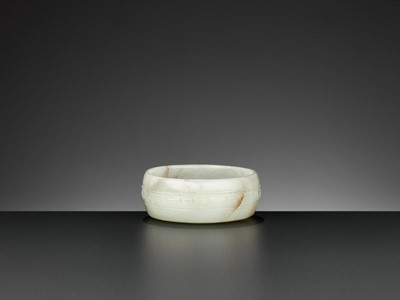Lot 94 - A PALE YELLOW AND CELADON JADE WASHER, MING DYNASTY