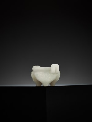 Lot 96 - A WHITE JADE 'ARCHAISTIC' MINIATURE TRIPOD CENSER, QING DYNASTY