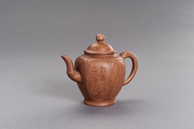Lot 435 - A YIXING CERAMIC TEAPOT AND COVER