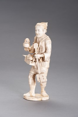 Lot 253 - AN IVORY AND BONE OKIMONO OF A TOY SELLER