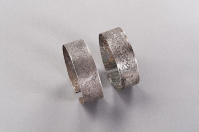 A PAIR OF SILVER BANGLES
