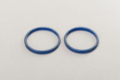FOUR BLUE GLASS BANGLES