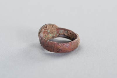AN ANCIENT COPPER RING WITH AN INTAGLIO