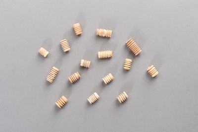 A LOT OF FIFTEEN TRIBAL IVORY BEADS