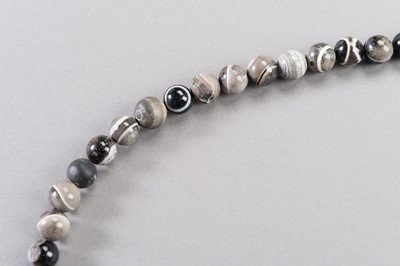 A LOT OF SIXTY SULEMANI BANDED ONYX BEADS