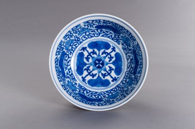 Lot 430 - A FAMILLE VERTE ENAMELED PORCELAIN 'LOTUS AND PEONY' BOWL