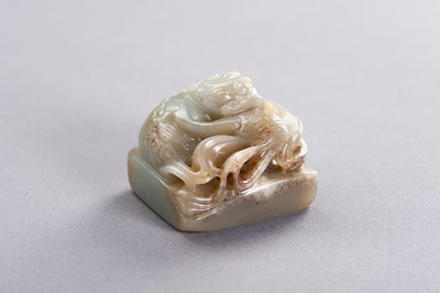 Lot 187 - A CELADON AND RUSSET JADE 'QILIN' SEAL, LATE QING TO REPUBLIC